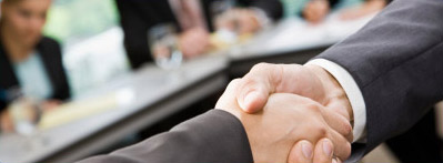 Two business partners shaking hands.